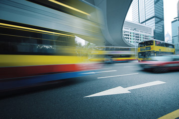 Long exposure photo of bus moving on road. Motion blur.