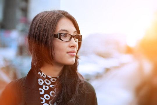 Portrait of asian businesswoman in city. Closeup.