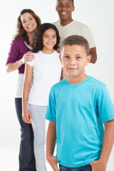 young boy with happy family in background