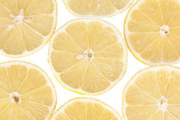 Sliced lemons isolated on white background
