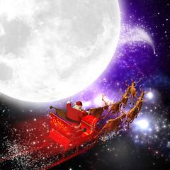 Weihnachtsmann mit Rentierschlitten bei Vollmond