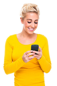 Attractive Woman Text Messaging on Mobile Phone