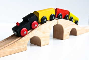 Toy wood train on overpass
