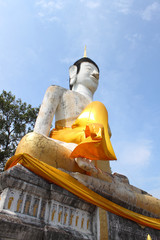 White sitting Budha in blue sky, Mahasarakham, Thailand.