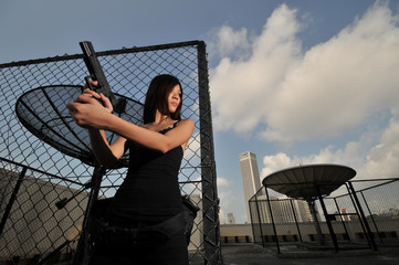 Woman Assasin/ cop on the rooftop