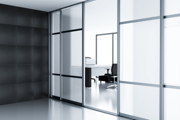 Empty cubicle behind a glass doors in modern office