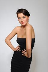 Beautiful sexy woman in short elegant dress dancing.