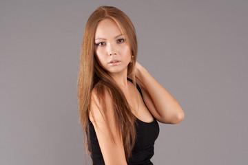 Asian model portrait wearing elegant dress with studio backgroun