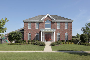 Large brick home with white columns