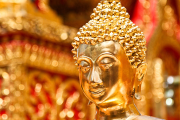 Gold face of Buddha statue in Doi Suthep temple,Thailand