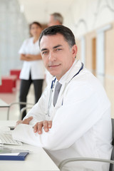 Closeup of doctor sitting in his office