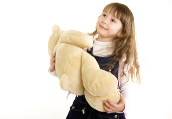 Photo of a happy little girl with toy
