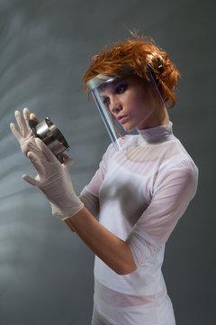 Scientist woman examine metal part concept