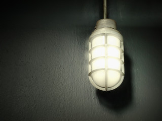steel gray lamp on the wall