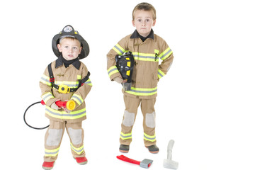 Two children dressed as firemen ready for duty