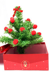 Red gift box and christmas tree