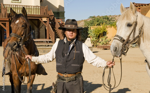 Wall mural Deputy Sheriff holding two horses by their reins