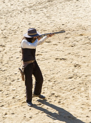 Fotomurales - Sheriff shooting Rifle on a film set