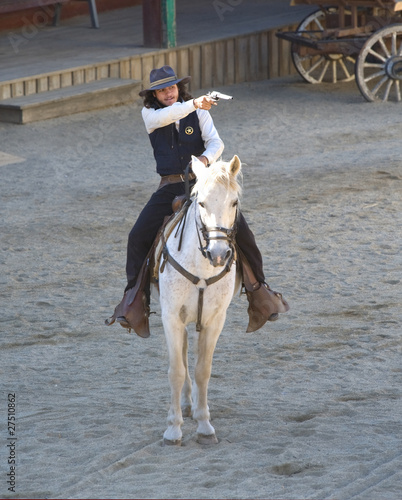 Wall mural Sheriff shooting his gun while riding his horse