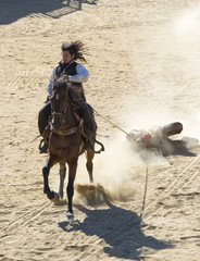 Fotomurales - Deputy Sheriff dragging a bandit by a rope off his horse