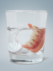 Dentures with cleaning tablet