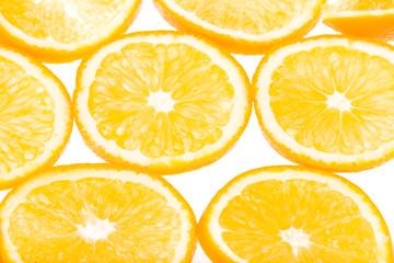Fresh oranges isolated on white background cut into wedges
