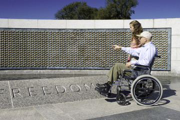 Grandfather in Wheelchair and Granddaughter at World War II Memo