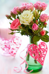 vase of roses and hearts