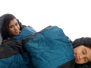 girls in camping sleeping bags