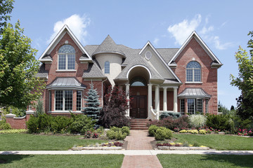 Luxury home with turret and arched entry