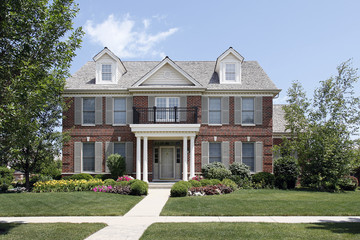 Brick home with front balcony