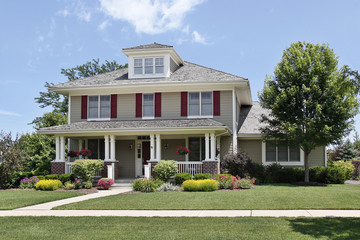 Suburban home with red shutters