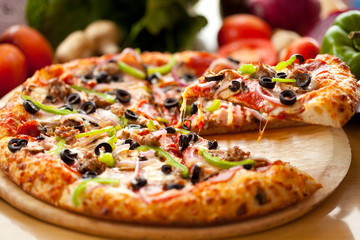 Supreme Pizza lifted slice 3