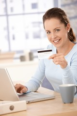 Young woman shopping on internet smiling