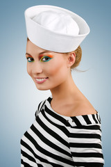 Attractive smiling young girl in sailor's cap