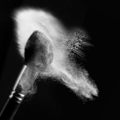 detail of a powder brush with white loose powder