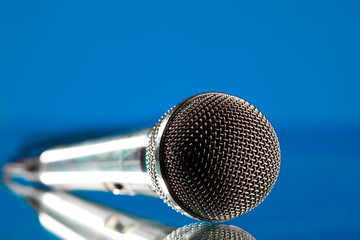 microphone against the blue background