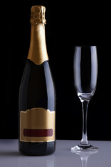 Champagne bottle isolated against a black background