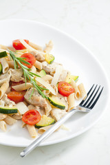 pasta penne with turkey meat and vegetables