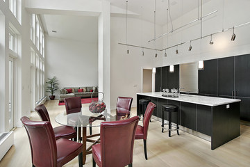 Twp story kitchen with black cabinetry