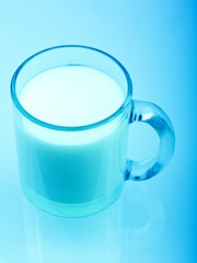 Blue toned glass of milk