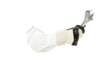 Plumber spanner with protective hand gloves, hand.