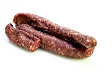 delicious fresh pork sausage cut in half on white background