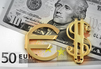 The money euro and dollars and golden sign
