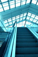 blue escalator in business center