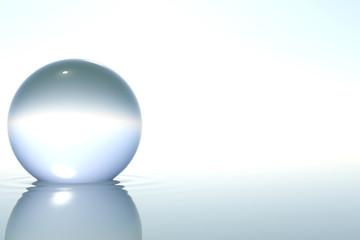 Fototapete - Zen glass sphere in water on white background