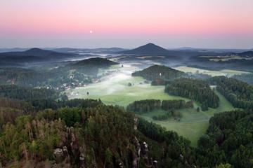 Sunrise in beautiful mountain Czech switzerland with inversion