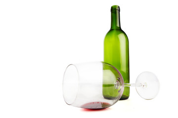 Emtpy wine bottle and glass