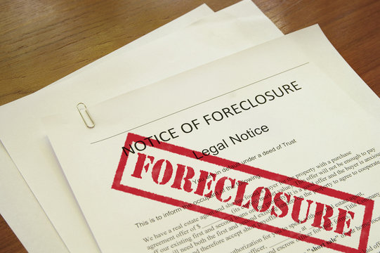mortgage foreclosure document with red stamped text