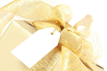 Golden christmas gift box with blank tag